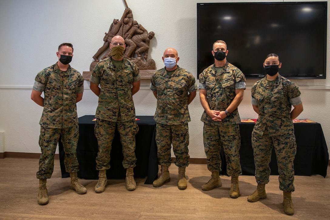 From left, U.S. Marine Corps Lance Cpl. Braden Reilly, administrative law clerk, U.S. Marine Corps Col. David Suggs, chief of staff, U.S. Marine Corps Maj. Gen. Austin Renforth, commanding general, U.S. Marine Corps Sgt. Maj. Jason Gillespie, sergeant major, and U.S. Marine Corps Cpl. Daniela Rascon-Polanco, administrative specialist, Marine Air Ground Task Force Training Command, Marine Corps Air Ground Combat Center, pose for a photo during a Servicemembers of the Quarter Honoree Luncheon at MCAGCC, Twentynine Palms, California, July 29, 2021. The event was hosted by the Armed Services Young Men's Christian Association Twentynine Palms to congratulate the honorees on their outstanding service over the spring quarter. (U.S. Marine Corps Photo by Lance Cpl. Joshua Sechser)