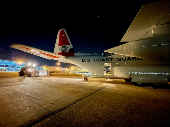 With the help of the Air National Guard's 164th Logistics Readiness Squadron, a U.S. Coast Guard HC-130 Hercules crew from Elizabeth City, N.C., loads the plane with 500,000 doses of the COVID vaccine in Memphis on July 14, 2021. This delivery was received by a U.S. embassy team in Haiti under the COVAX program on behalf of the U.S. Health and Human Services — a gift from the American people to the people of Haiti.