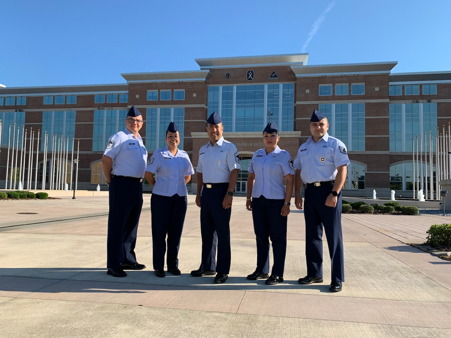 Five NCOs from IAAFA pose for group photo.