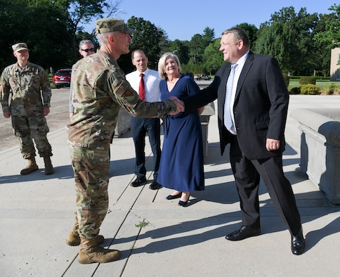 Maj. Gen. Christopher Azzano, commander, Air Force Test Center, is greeted by Brian Stacy, action officer, and AEDC leadership upon his arrival at Arnold Air Force Base, Tenn., June 30, 2021. (U.S. Air Force photo by Jill Pickett)