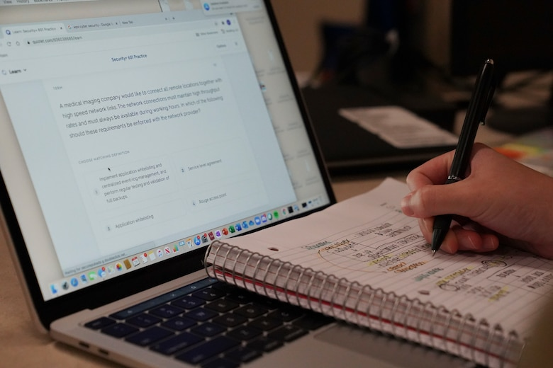 U.S. Air Force Airman Madelyn Brown, 336th Training Squadron cyber transport student, takes notes during class inside Thompson Hall at Keesler Air Force Base, Mississipi, July 26, 2021. As a yellow rope, Brown has taken a charge early to become a leader amongst her peers. (U.S. Air Force photo by Senior Airman Spencer Tobler)
