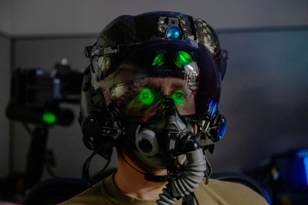 U.S. Air Force Tech. Sgt. Anthony Farnsworth, 419th Operations Support Squadron, poses for a photo to demonstrate the F-35 Generation III Helmet-Mounted Display at Hill Air Force Base, Utah, on July 10, 2021. The display provides the pilot critical information, built-in night vision, and allows a 360-degree view of the aircraft's outside environment.