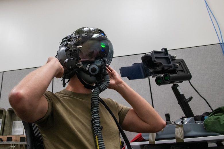 U.S. Air Force Tech. Sgt. Anthony Farnsworth, 419th Operations Support Squadron, adjusts an F-35 helmet during optical fit training at Hill Air Force Base, Utah, on July 10, 2021. Each helmet is inspected every 105 days and has a 120-day fit check to ensure its functionality and safety.