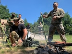 Air Force technical sergeant translates at a survival briefing.