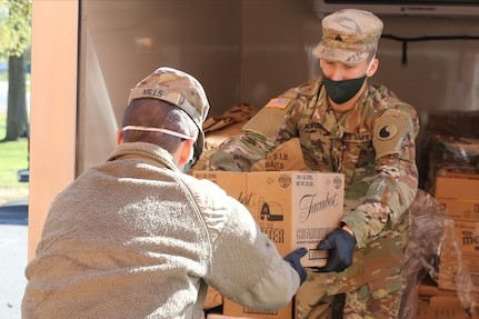 Virginia National Guard Soldiers assigned to the Fredericksburg-based 229th Brigade Engineer Battalion, 116th Infantry Brigade Combat Team, help deliver food from the Fredericksburg Regional Food Bank to the food pantry at Massaponax Baptist Church April 22, 2020, in Fredericksburg, Virginia.