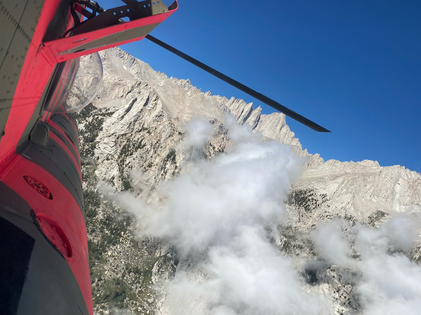 A U.S. Army CH-47F Chinook helicopter from the California Army National Guard's Army Aviation Support Facility in Stockton, California, flies near Mount Whitney in Inyo County July 27, 2021, during a search and rescue mission for three hikers who were stranded above 12,600 feet overnight with few supplies.