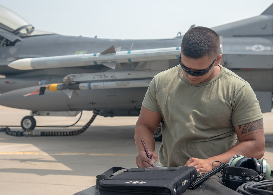 U.S. Air National Guard Staff Sgt. Saud Ahlschlager, an F-16C crew chief, 114th Fighter Wing, reviews aircraft forms during Combat Raider at Ellsworth Air Force Base, S.D., July 20, 2021.