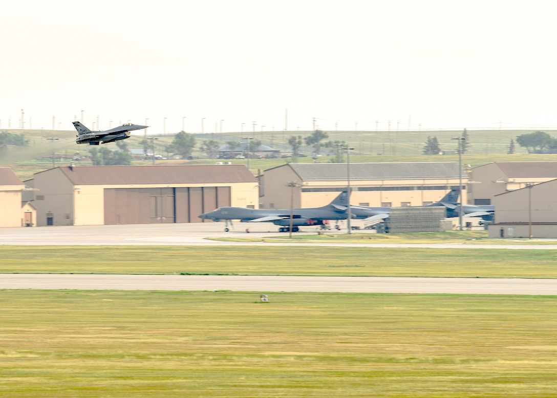 A U.S. Air National Guard F-16C from the 114th Fighter Wing takes off to participate in Combat Raider from Ellsworth Air Force Base, S.D., July 20, 2021.