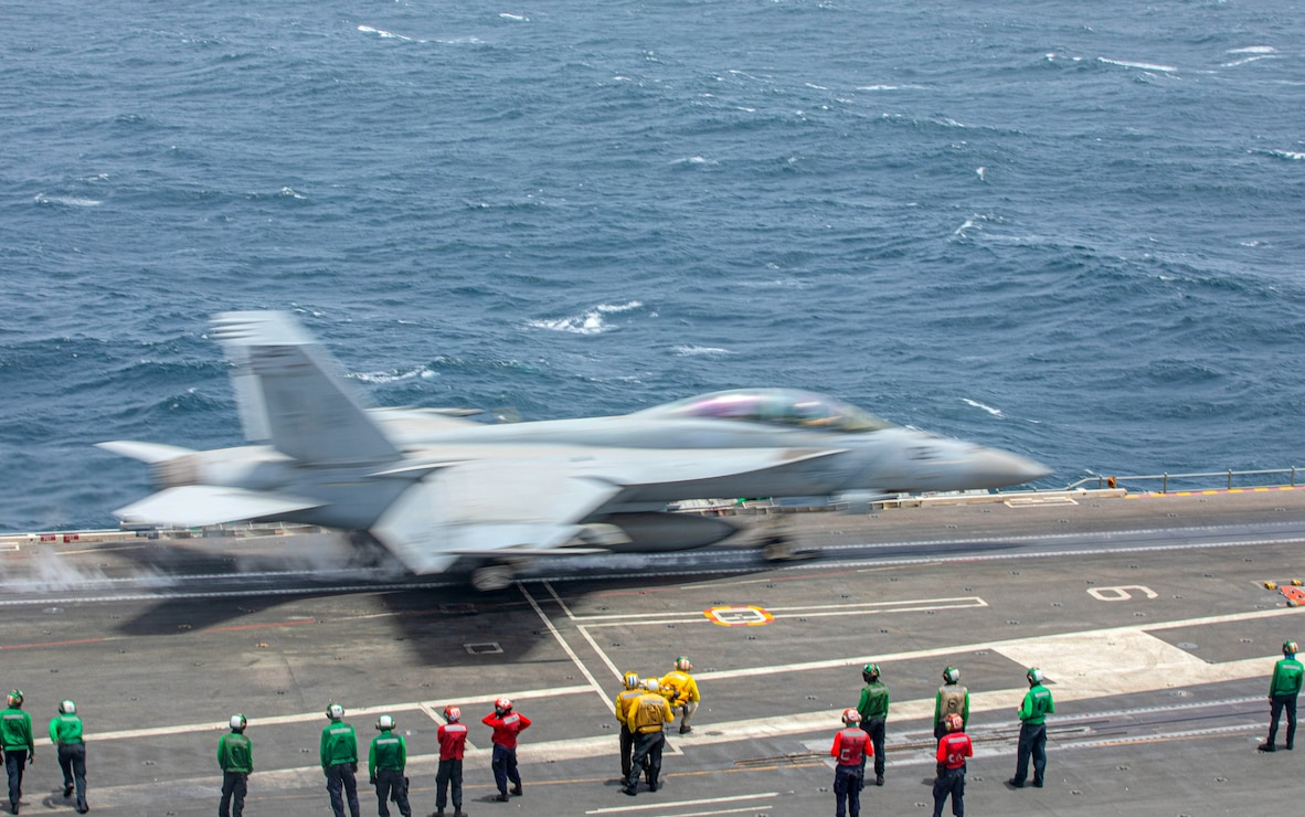 """An F/A-18F Super Hornet fighter jet, attached to the """"Diamondbacks"""" of Strike Fighter Squadron (VFA) 102, launches from the flight deck of the aircraft carrier USS Ronald Reagan (CVN 76) in the Arabian Sea."""