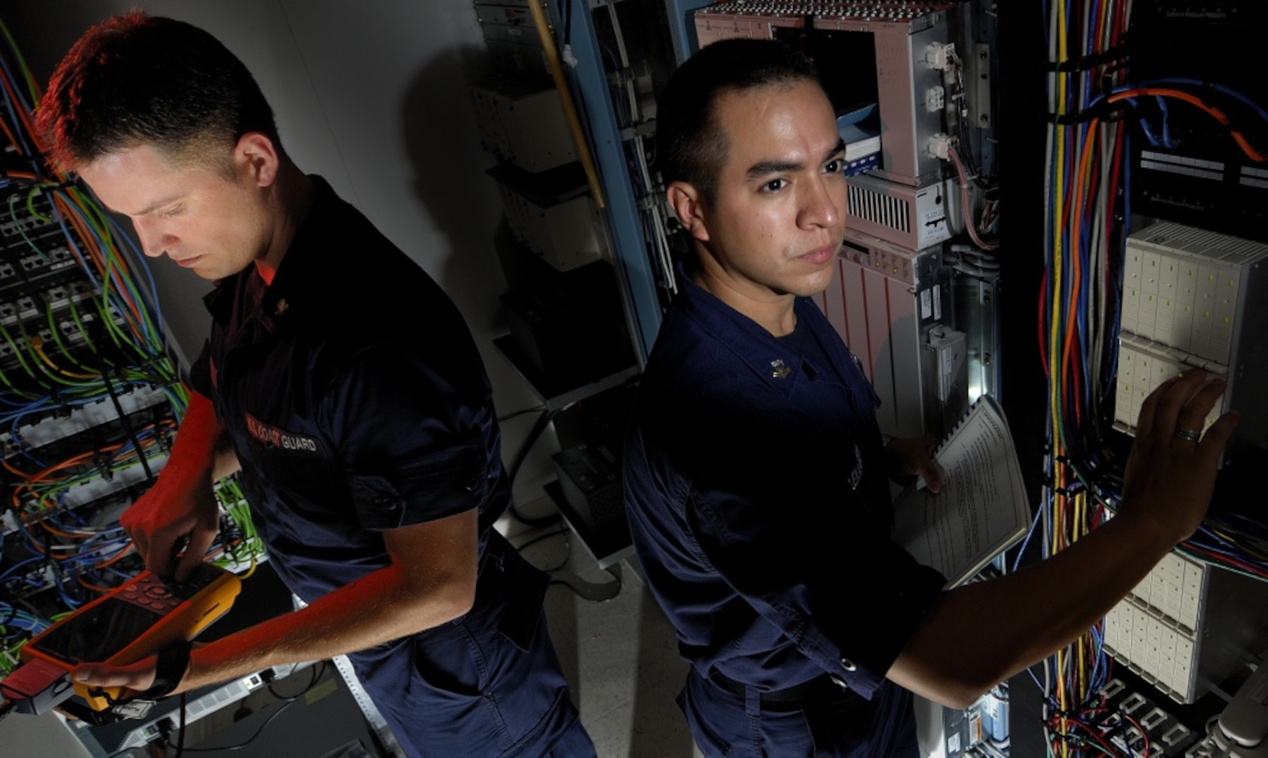 Coast Guard Petty Officer 2nd Class Jason Guard and Petty Officer 2nd Class Carlos Alexander, in a server room located at Coast Guard Sector New York on Fort Wadsworth, Staten Island, New York, June, 26, 2007. Coast Guard information systems technician's are responsible for establishing and maintaining Coast Guard systems. U.S. Coast Guard photo by Chief Petty Officer Tom Sperduto