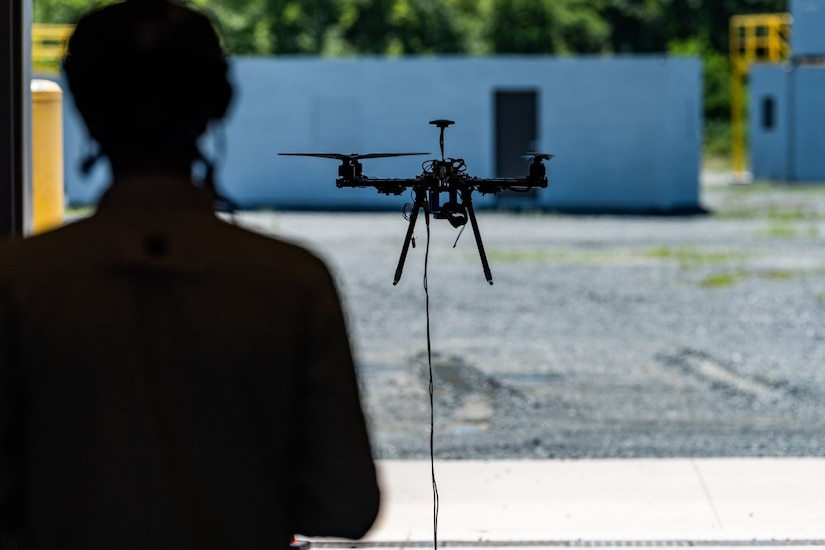 A person operates a hovering drone.