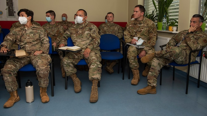 Members of the 480th Expeditionary Fighter Squadron and the 52nd Operations Group Detachment 1, listen to Polish firefighters assigned to the 32nd Tactical Air Base talk about emergency responder expectations at Łask Air Base, Poland, July 28, 2021. The event, which was in preparation for the upcoming Aviation Detachment Rotation, allowed attendees to review and discuss emergency response reaction time and the responsibilities of everyone involved. (U.S. Air Force photo by Tech. Sgt. Anthony Plyler)