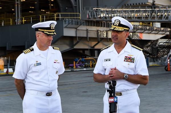 SAN DIEGO (August 2, 2021) Capt. P. Scott Miller, left, commanding officer of Nimitz-class aircraft carrier USS Carl Vinson (CVN 70), and Rear Adm. Daniel Martin, right, commander, Carrier Strike Group (CSG) 1, speak with local media.