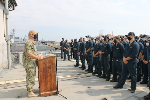 NAVAL STATION NORFOLK (Aug. 2, 2021) – Rear Adm. Brendan McLane, commander, Naval Surface Force Atlantic, speaks to the crew of the guided-missile cruiser USS San Jacinto (CG 56). McLane presented the crew with the Navy Unit Commendation for their leadership and hard work in support of the Dwight D. Eisenhower Carrier Strike Group during their 2020 deployment, which lasted 206 days with no port visits. (U.S. Navy photo by Boatswain's Mate 3rd Class Danielle Bordine/Released)