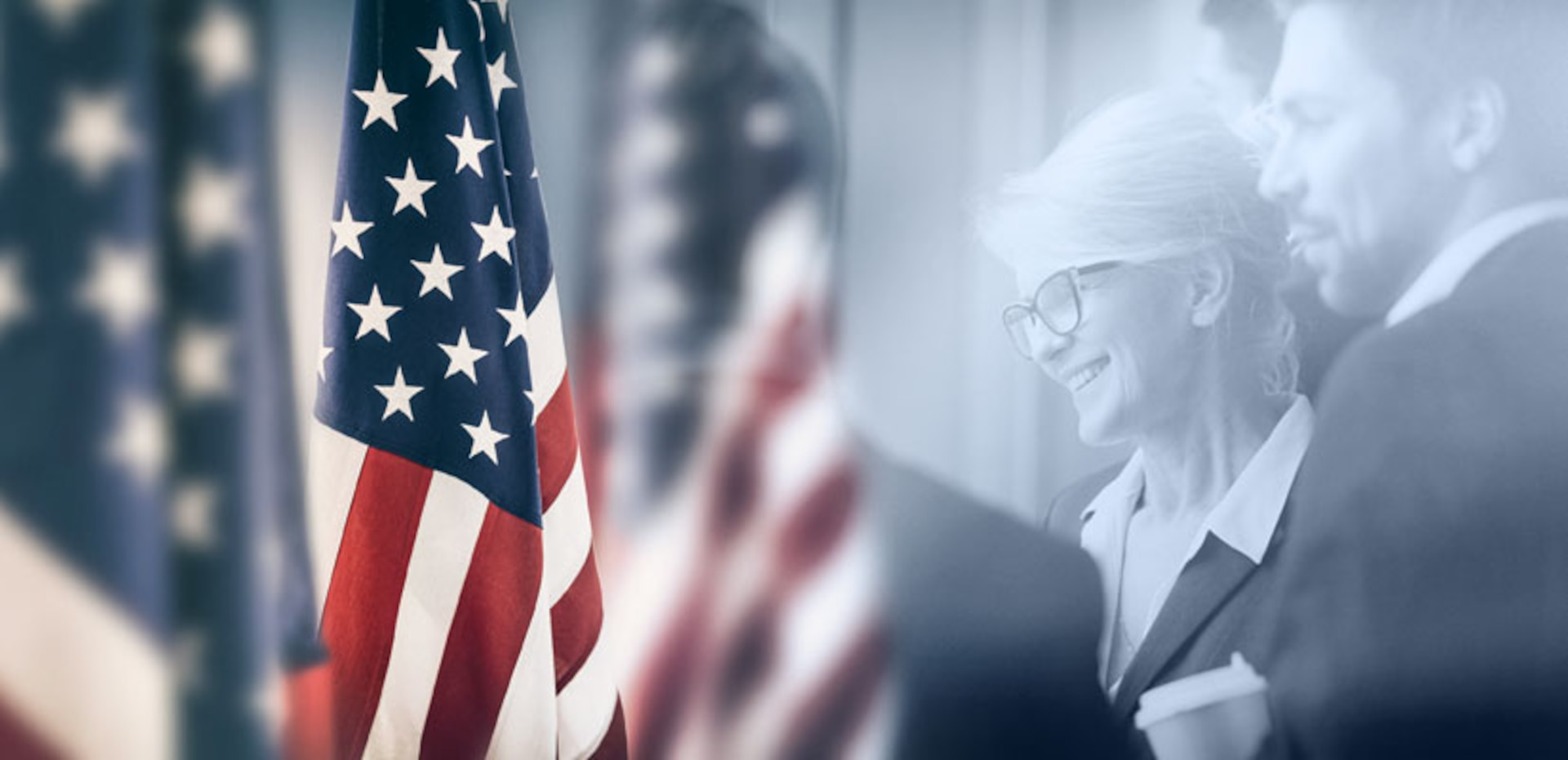 American flag inlaid over two business persons.