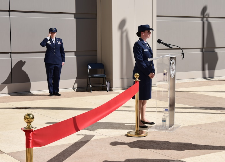 Major General DeAnna Burt, Combined Force Space Component Command commander, welcomes guests at the ribbon-cutting ceremony.