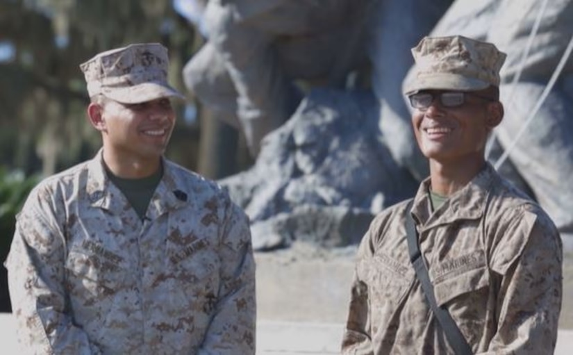 A video screen grab of two Marines standing next to each other.