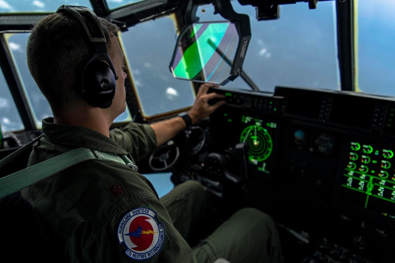 A pilot flies a plane.