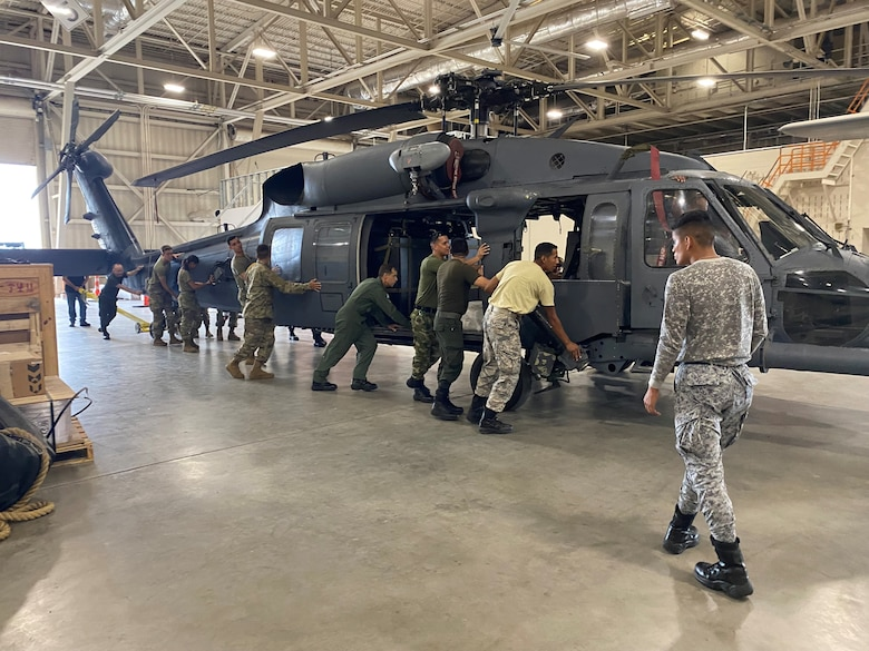 IAAFA instructors work on helicopter