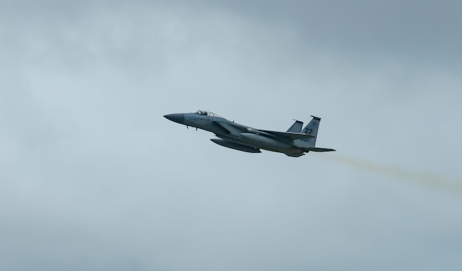 A U.S. Air Force F-15C Eagle flies over Kadena Air Base, Japan, during Pacific Iron, July 26, 2021. Pacific Iron is a U.S. Pacific Air Forces dynamic force employment operation to project forces into the USINDOPACOM's area of responsibility in support of the 2018 National Defense Strategy which called on the military to be a more lethal, adaptive, and resilient force. (U.S. Air Force photo by Airman 1st Class Moses Taylor)