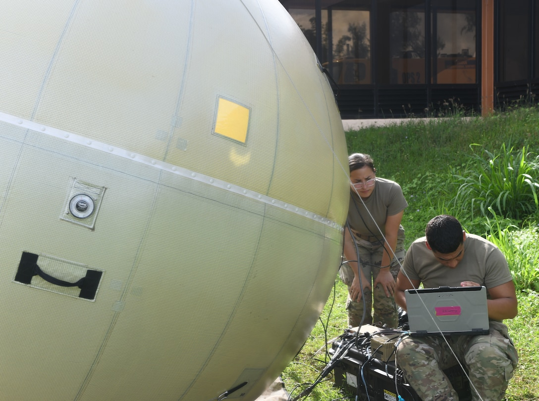 Airmen from the 644th Combat Communications Squadron, Andersen Air Force Base, Guam, set up network satellite communications through a Ground Antenna Transmit and Receive at Tinian International Airport, Tinian, during Pacific Iron 2021, July 26, 2021. Approximately 800 Airmen and 35 aircraft are participating in Pacific Air Forces' dynamic force employment operation July 11 to Aug. 8, 2021, in Guam and Tinian to project forces into the U.S. Indo-Pacific Command's area of responsibility in support of the 2018 National Defense Strategy, calling on the military to be a more lethal, adaptive and resilient force. (U.S. Air Force photo by Tech. Sgt. Benjamin Sutton)