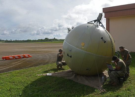 Servicemembers from the 644th Combat Communications Squadron, Andersen Air Force Base, Guam, set up network satellite communications through a Ground Antenna Transmit and Receive at Tinian International Airport, Tinian, during Pacific Iron 2021, July 26, 2021. Pacific Iron 2021 is a Pacific Air Forces dynamic force employment operation to project forces into USINDOPACOM's area of responsibility in support of the 2018 National Defense Strategy which called on the military to be a more lethal, adaptive, and resilient force. (U.S. Air Force photo by Tech. Sgt. Benjamin Sutton)