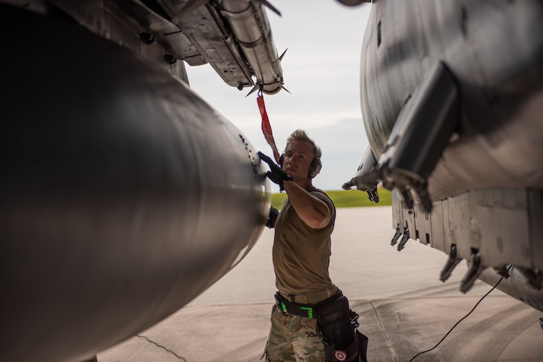 U.S. Air Force Staff Sgt. Zachary Williams, weapons standardization load crew chief assigned to the 389th Fighter Squadron, post loads an AIM-9X while conducting an Integrated Combat Turn on Andersen Air Force Base, Guam, July 24, 2021. Performing ICTs decreases the aircrews' time on the ground and increases the Air Force's ability to meet new challenges in dynamic environments. (U.S. Air Force photo by Airman 1st Class Andrea Rozoto)
