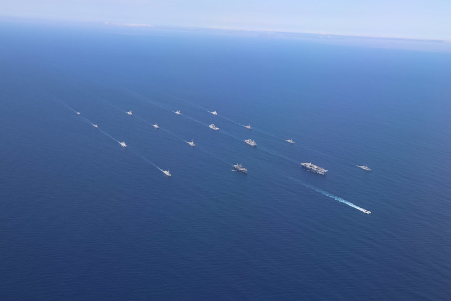 HMS Queen Elizabeth and USS The Sullivans with the United Kingdom Carrier Strike Group joined ships with NATO Standing Maritime Groups One and Two for an impressive display of maritime power in the Eastern Atlantic on 28 May 2021.