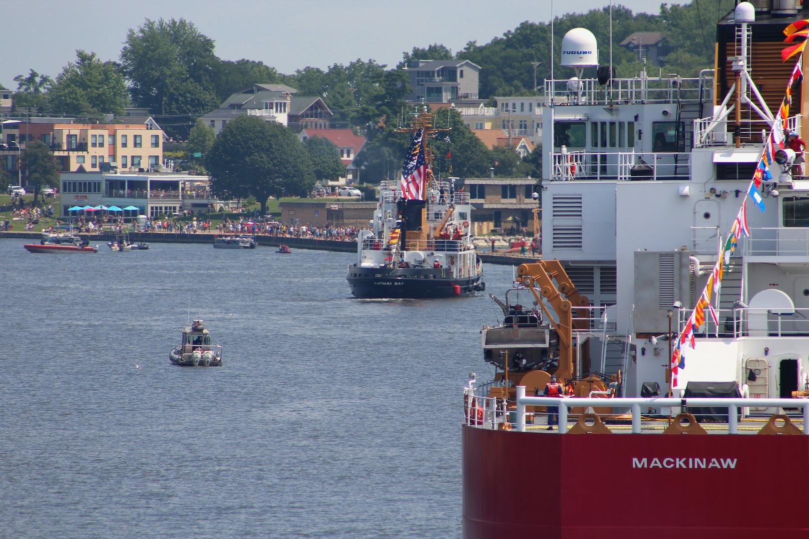 U.S. Coast Guard Cutter Mackinaw follows the Cutter Katmai Bay up the Grand Haven Channel during the Parade of Ships at the Grand Haven Coast Guard Festival in Grand Haven, Michigan, Aug. 2, 2021. (Coast Guard photo)