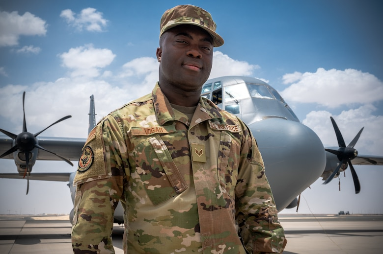 Senior Airman Ajay Vogar, 379th Expeditionary Maintenance Squadron commander support staff security manager, poses for a photo at Al Udeid Air Base, Qatar, July 19, 2021.