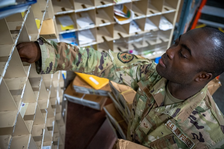 Senior Airman Ajay Vogar, 379th Expeditionary Maintenance Squadron commander support staff security manager, picks up mail from the post office, at Al Udeid Air Base, Qatar, July 27, 2021.