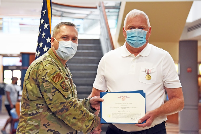 87th Medical Group commander honors award to 87th MDG pharmacist.