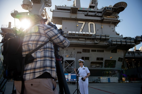 Lt. Cmdr. Miranda Williams, public affairs officer of the Nimitz-class aircraft carrier USS Carl Vinson (CVN 70) and Carrier Strike Group (CSG) 1, speaks with local media.