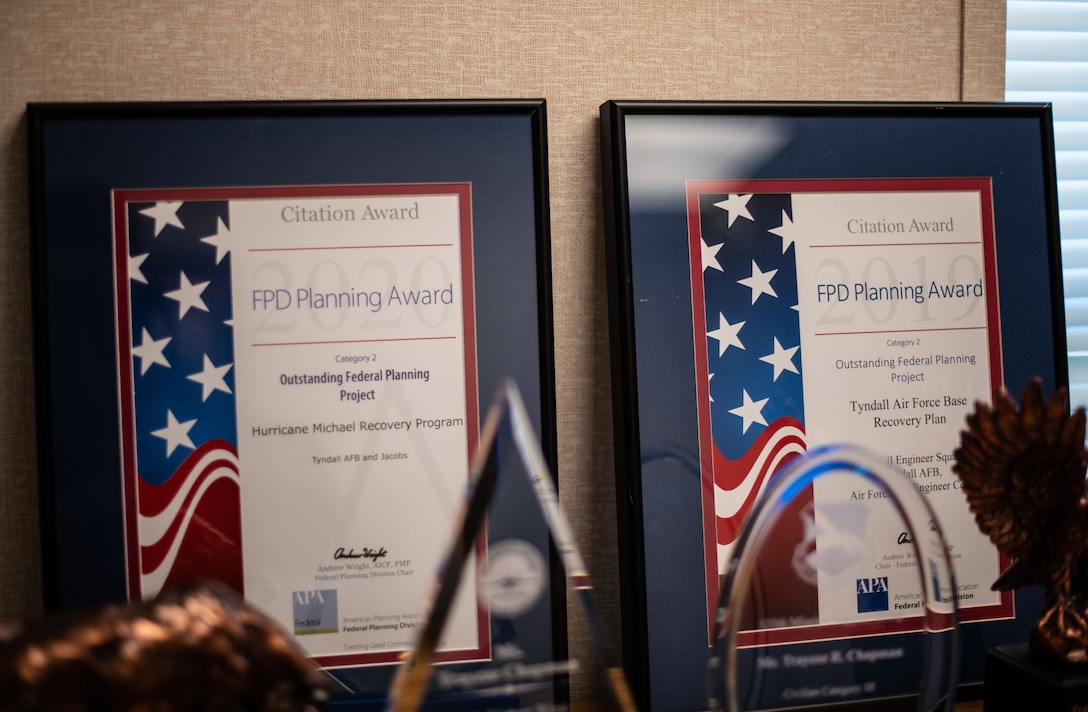 Two award plaques sit on the background, showing consecutive annual winnings