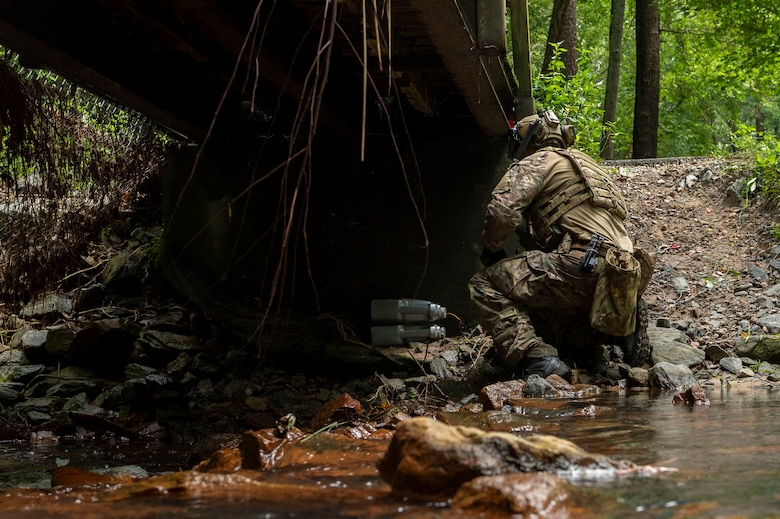 Staff Sgt. Damian Riley, 4th Civil Engineer Squadron explosive ordnance disposal technician, hooks up a remote cut and pull on a simulated improvised explosive device during field training exercise Operation Guillotine at Seymour Johnson Air Force Base, North Carolina, July 26, 2021.