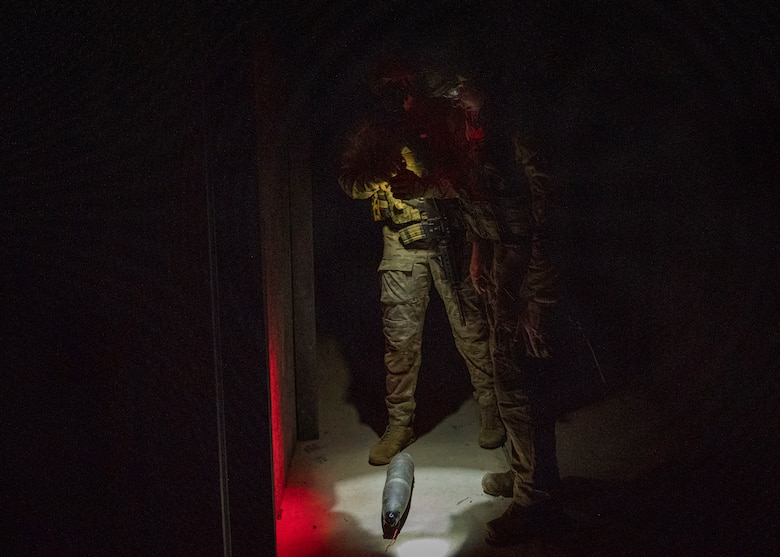 Explosive Ordnance Disposal technicians find a training improvised explosive device during field training exercise Operation Guillotine at Seymour Johnson Air Force Base, North Carolina, July 29, 2021.