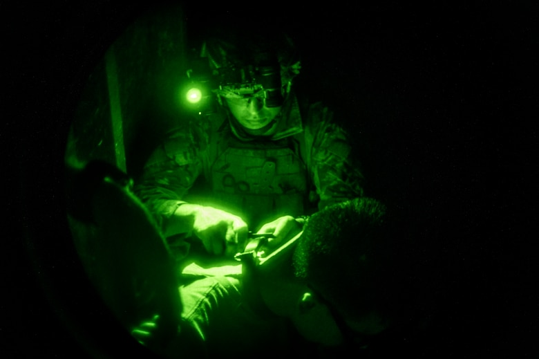 Airman 1st Class Jakobo Vasquez Cuartas, 20th Civil Engineer Squadron explosive ordnance disposal technician, removes a training neck bomb during field training exercise Operation Guillotine at Seymour Johnson Air Force Base, North Carolina, July 29, 2021.