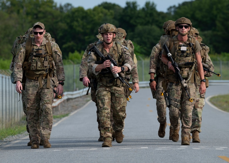 Explosive ordnance disposal members from Seymour Johnson Air Force Base, North Carolina, Andrews AFB, Maryland and Shaw AFB, South Carolina, ruck march to a training site on Seymour Johnson AFB, July 25, 2021. The EOD members participated in a five-day field training exercise, Operation Guillotine. (U.S. Air Force photo by Senior Airman Kimberly Barrera)
