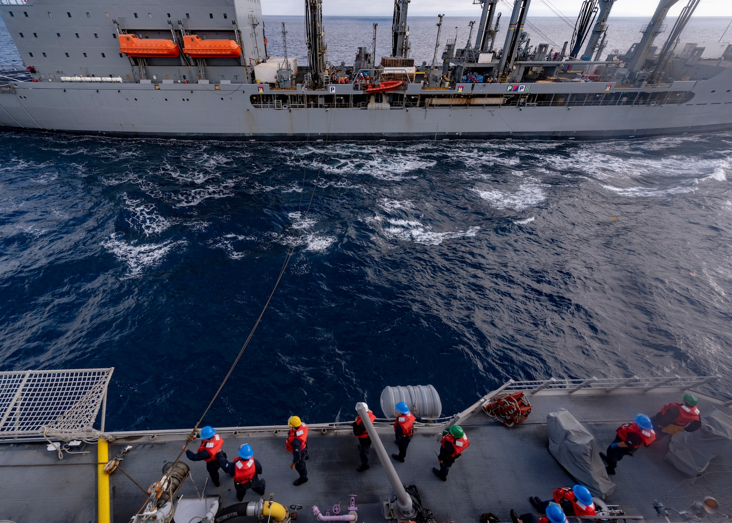Sailors assigned to the Independence-variant littoral combat ship USS Coronado (LCS 4) heave a line.