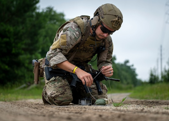 Airman 1st Class Braiden Bray, 4th Civil Engineer Squadron explosive ordnance disposal technician sets up a remote move on a dud-fired hand grenade during field training exercise Operation Guillotine at Seymour Johnson Air Force Base, North Carolina, July 27, 2021.