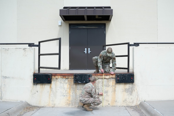 Staff Sgt. Justin Manning, right, 341st Missile Wing occupational safety technician, and Tech. Sgt. Mark Allen, left, 341st MW occupational safety NCO in charge, measure the height of a loading dock Aug. 2, 2021, at Malmstrom Air Force Base, Mont.