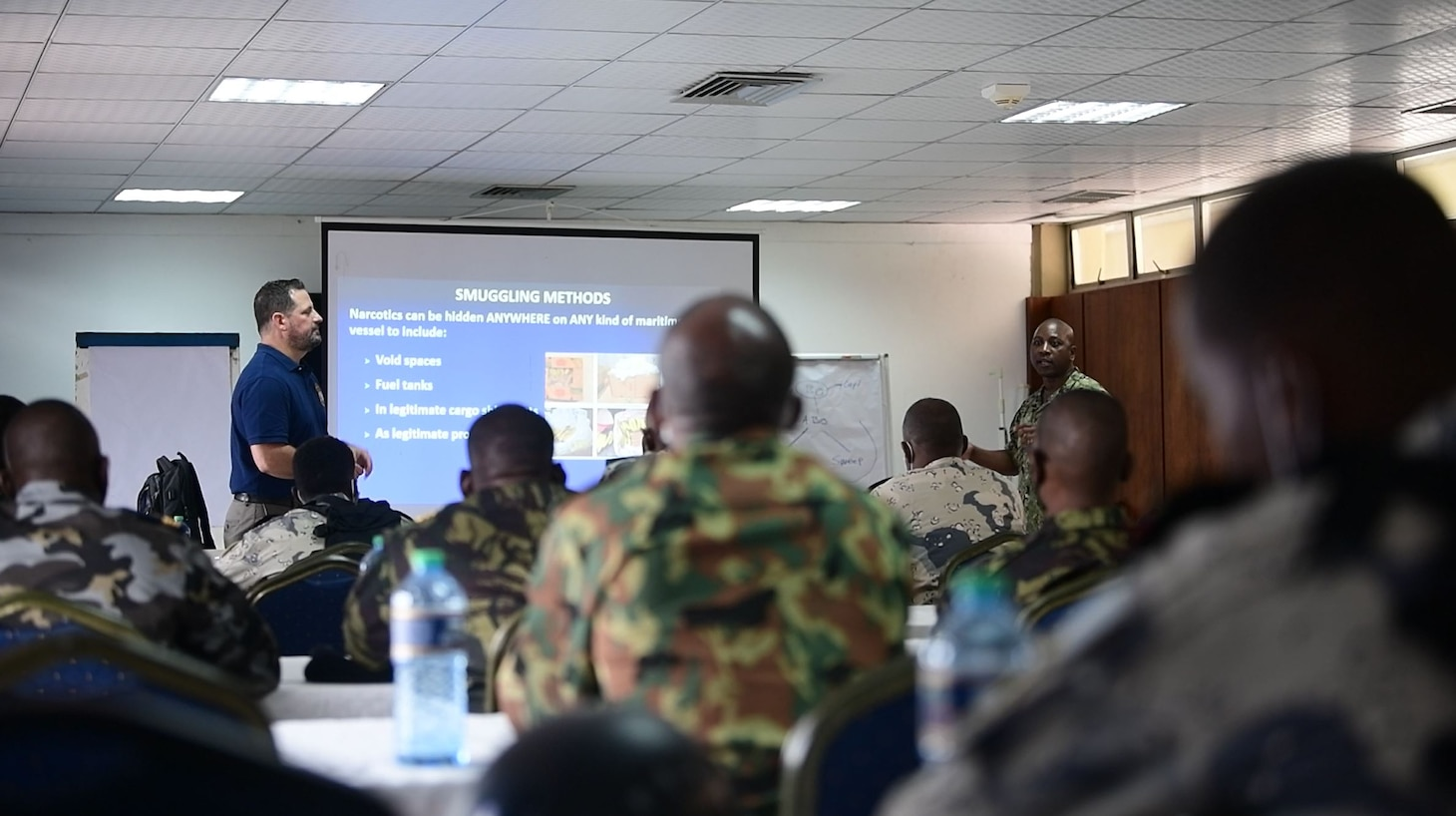 (Aug. 2, 2021) Hospital Corpsman 1st Class Marcelin Aggossou, right, translates during a training evolution as part of Cutlass Express 2021 in East Africa, Aug. 2, 2021. Cutlass Express is designed to improve regional cooperation, maritime domain awareness and information sharing practices to increase capabilities between the U.S., East African and Western Indian Ocean nations to counter illicit maritime activity.