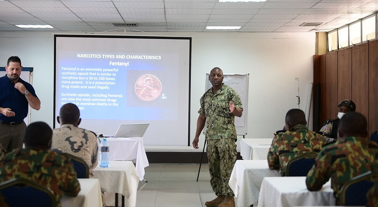 (Aug. 2, 2021) Hospital Corpsman 1st Class Marcelin Aggossou translates during a training evolution as part of Cutlass Express 2021 in East Africa, Aug. 2, 2021. Cutlass Express is designed to improve regional cooperation, maritime domain awareness and information sharing practices to increase capabilities between the U.S., East African and Western Indian Ocean nations to counter illicit maritime activity. (U.S. Navy photo by Mass Communication Specialist 1st Class Ridge Leoni)