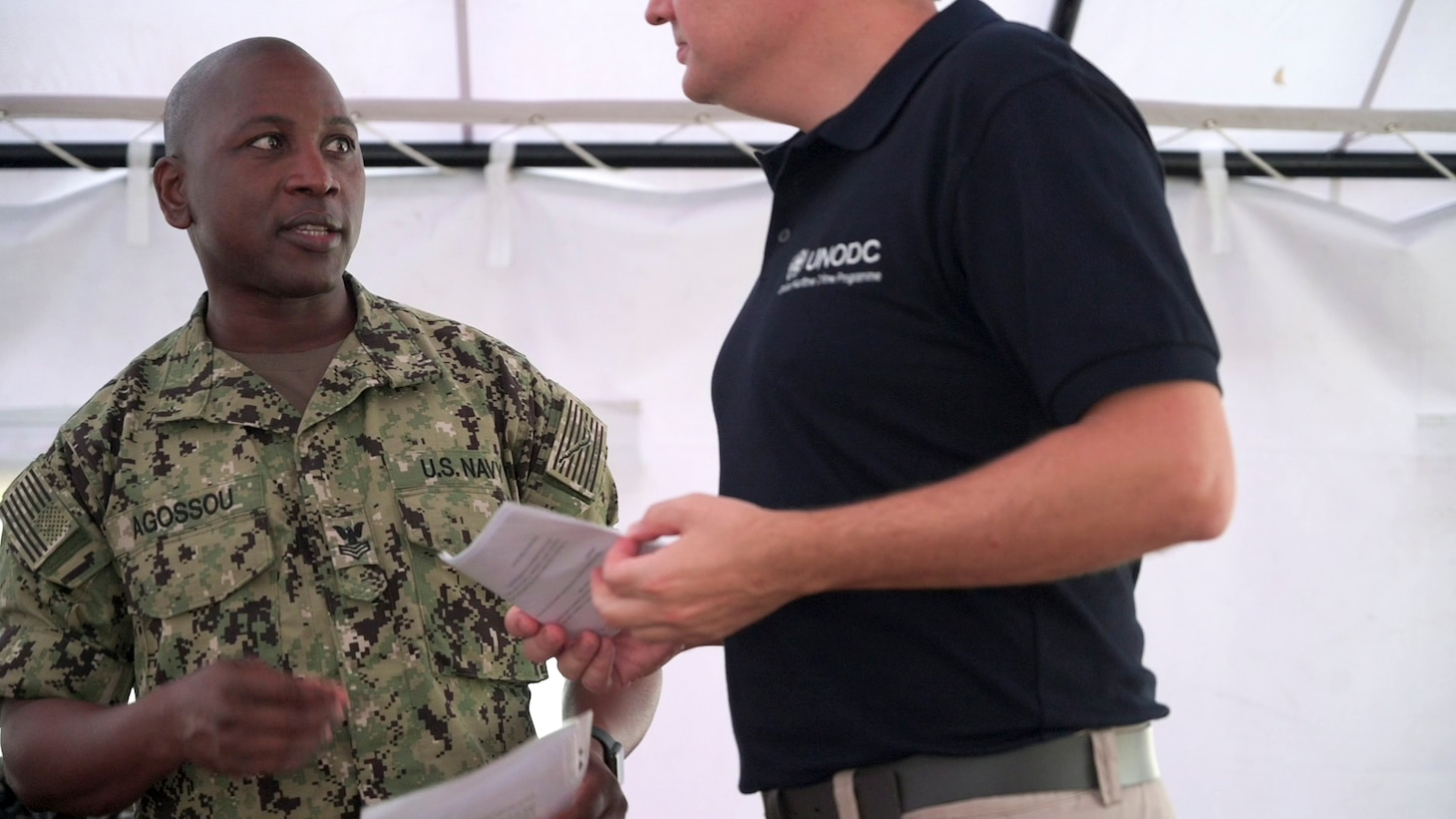 (Aug. 2, 2021) Hospital Corpsman 1st Class Marcelin Aggossou translates during a training evolution as part of Cutlass Express 2021 in East Africa, Aug. 2, 2021. Cutlass Express is designed to improve regional cooperation, maritime domain awareness and information sharing practices to increase capabilities between the U.S., East African and Western Indian Ocean nations to counter illicit maritime activity.