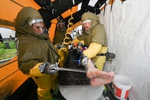 66th Medical Squadron In-Place Patient Decontamination Team members Airman 1st Class Ray Infante, left, and Master Sgt. Julio Arriola, participate in a Ready Eagle exercise at Hanscom Air Force Base, Mass., July 30. The full-scale disaster response exercise tested Hanscom medics on their response to a chemical, biological, radiological, nuclear or explosive event. (U.S. Air Force photo by Todd Maki)