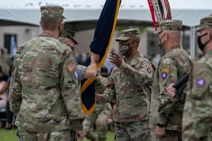 Marine Corps Gen. Kenneth McKenzie, Commander of U.S. Central Command, passes the U.S. Army Central colors to incoming Commanding General, Lt. Gen. Ronald P. Clark, during the Army Service Component Command's Change of Command ceremony at Patton Hall's Lucky Park on Shaw Air Force Base, S.C., Aug. 4, 2021. During the ceremony, Clark assumed command from outgoing Commanding General, Lt. Gen. Terry Ferrell. (U.S. Army photo by Sgt. Leo Jenkins)