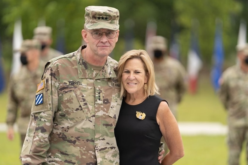 U.S. Army Central's outgoing Commanding General, Lt. Gen. Terry Ferrell, and his wife, Retired Col. Robbie Ferrell, shared messages of gratitude with family, friends, and fellow USARCENT teammates following USARCENT's Change of Command ceremony at Patton Hall's Lucky Park on Shaw Air Force Base, S.C., Aug. 4, 2021. Ferrell assumed command of USARCENT on March 8, 2019, and relinquished USARCENT command to Lt. Gen. Ronald P. Clark before culminating his 38-year career with an afternoon retirement ceremony. (U.S. Army photo by Sgt. Leo Jenkins)