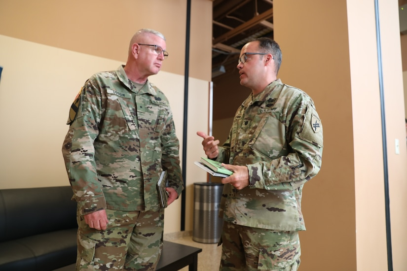U.S. Army Reserve Brig. Gen. Jeffrey C. Coggin, commanding general of the U.S. Army Civil Affairs and Psychological Operations Command (Airborne), receives a back brief from Lt. Col. Daniel C. Schmidt, G35 operations chief for USACAPOC(A), while participating in the Joint Warfighting Assessment 2021 distinguished visitor day initial briefing at Fort Carson, Colo., June 25, 2021. USACAPOC(A) Civil Affairs, Psychological Operations, and Information Operations Soldiers took part in JWA 2021 with participants from different Army units and multinational partners such as U.K., Australian and Canadian armed forces, working to improve interoperability between U.S. joint forces and our allies. JWA exercises help the Army evaluate emerging concepts, integrate new technologies, and promote interoperability between the Army, other services, and our multinational partners. Joint and multinational partners are key to the success of Multi-Domain Operations.