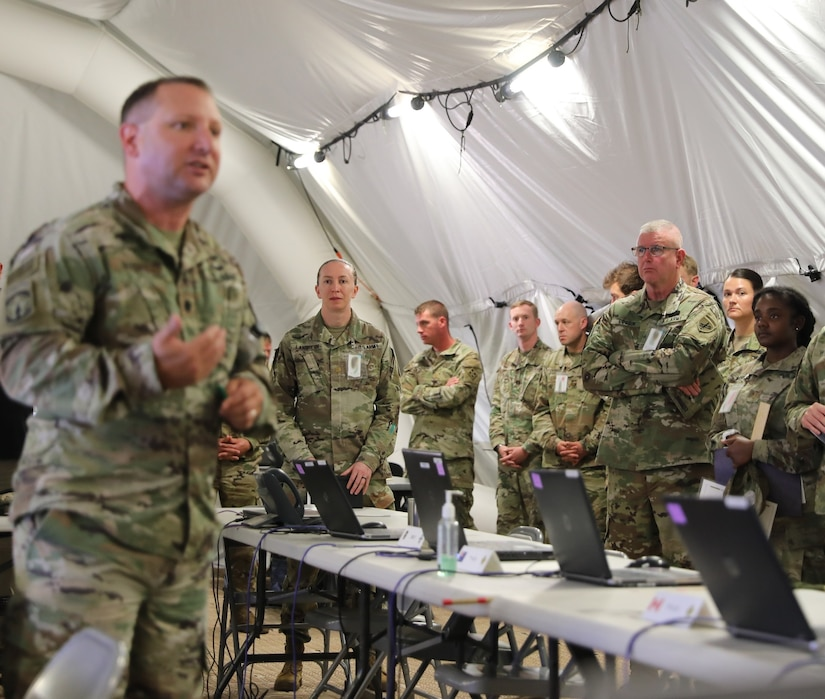 U.S. Army Reserve Brig. Gen. Jeffrey C. Coggin (center right), commanding general of the U.S. Army Civil Affairs and Psychological Operations Command (Airborne), participates in the Joint Warfighting Assessment 2021 distinguished visitor at Fort Carson, Colo., June 25, 2021. USACAPOC(A) Civil Affairs, Psychological Operations, and Information Operations Soldiers took part in JWA 2021 with participants from different Army units and multinational partners such as U.K., Australian and Canadian armed forces, working to improve interoperability between U.S. joint forces and our allies. JWA exercises help the Army evaluate emerging concepts, integrate new technologies, and promote interoperability between the Army, other services, and our multinational partners. Joint and multinational partners are key to the success of Multi-Domain Operations.