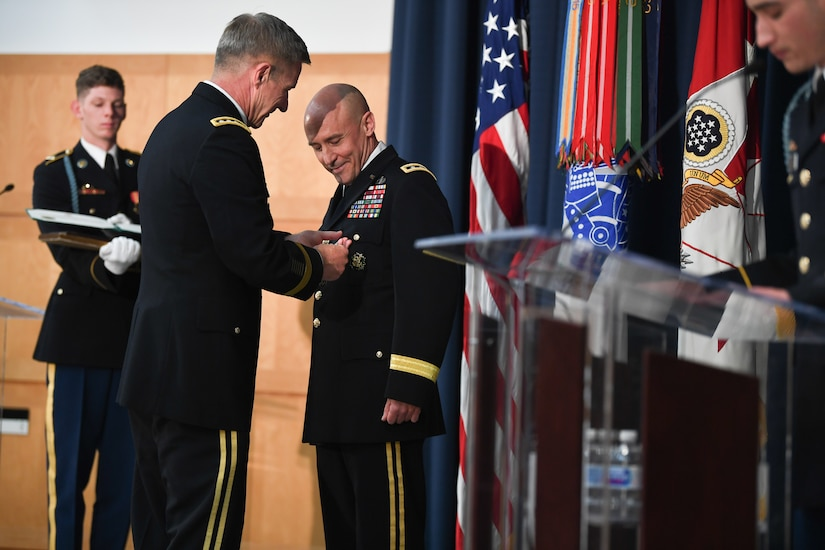U.S. Army Gen. James C. McConville presents the Distinguished Service Medal to U.S. Army Lt. Gen. Thomas A. Horlander during a retirement ceremony at Lincoln Hall, Ft. McNair in Washington, D.C., June 23, 2021.  (U.S. Army photo by Joseph B. Lawson)